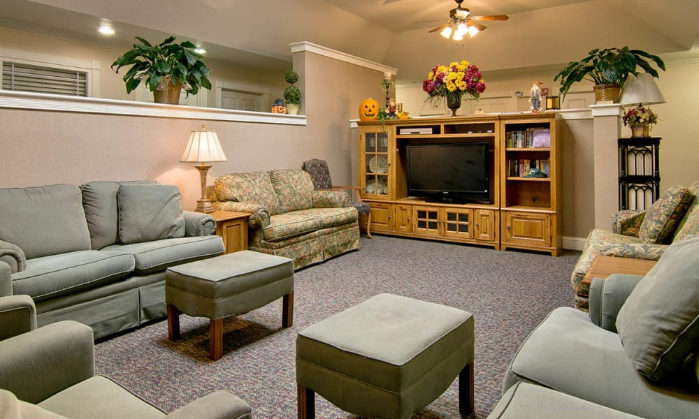 Entertainment room with comfortable seating at Silver Creek Senior Living in Joplin, Missouri