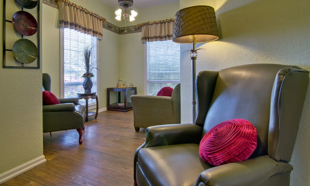 Quiet seating for memory care available at Ravenwood Senior Living in Springfield, Missouri