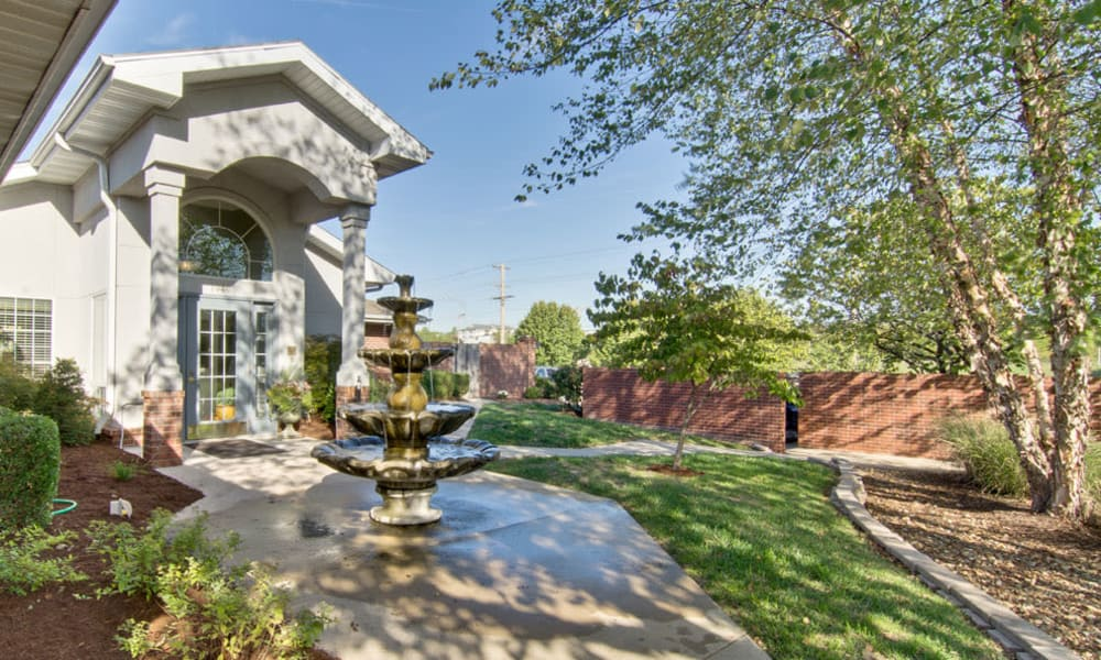 Courtyard with a fountain at Ravenwood Senior Living in Springfield, Missouri