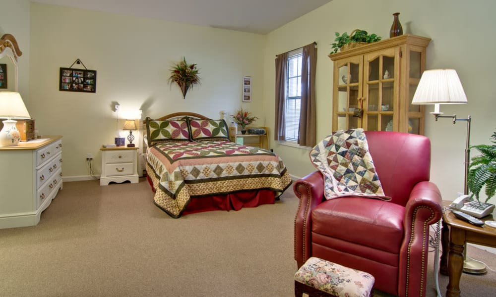 Large bedroom at Olive Grove Terrace Senior Living community in Olive Branch, Mississippi