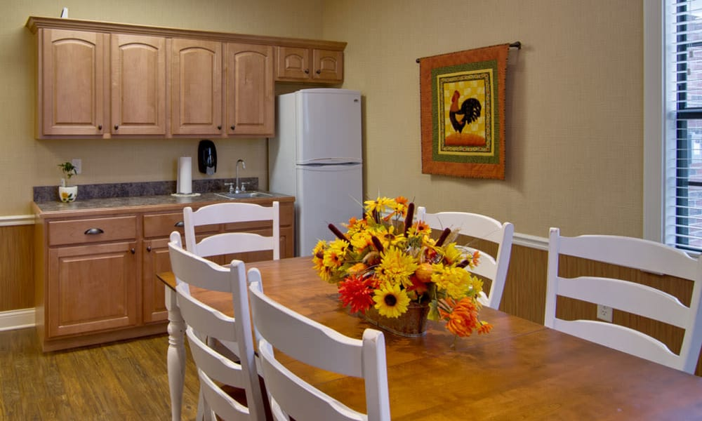 Community kitchen with accessible counters at Olive Grove Terrace Senior Living in Olive Branch, Mississippi