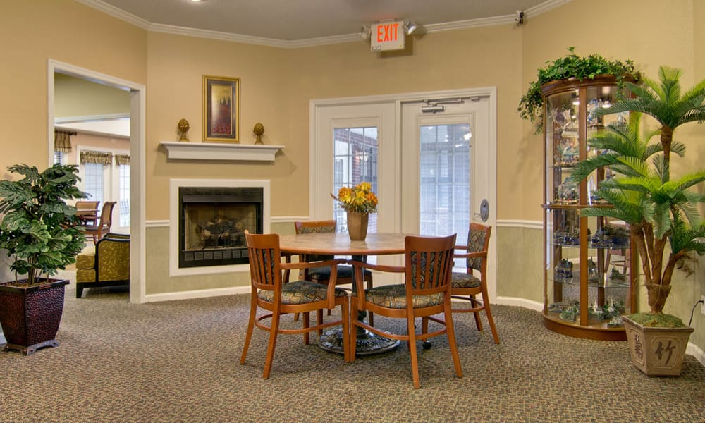 Quiet reading space within the entertainment room at Olive Grove Terrace Senior Living in Olive Branch, Mississippi