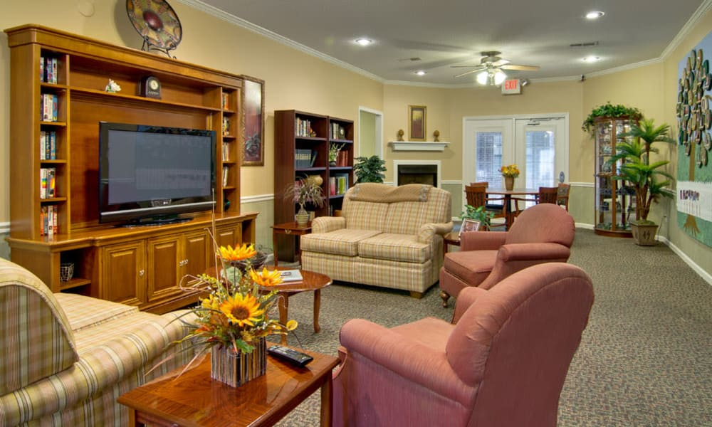 Entertainment room with comfortable seating at Olive Grove Terrace Senior Living in Olive Branch, Mississippi