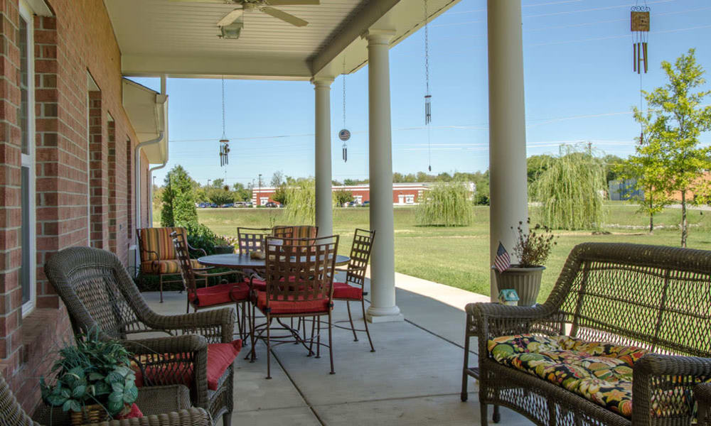 Front porch with comfortable seating at Azalea Court Senior Living in Smyrna, Tennessee