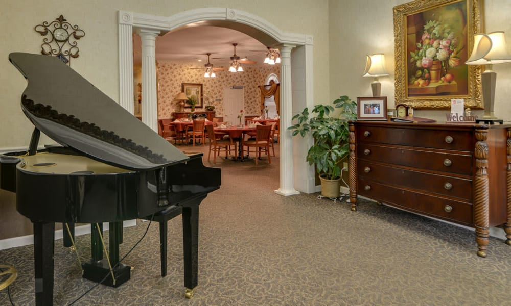 Music room with a view of the dining room at Azalea Court Senior Living in Smyrna, TN