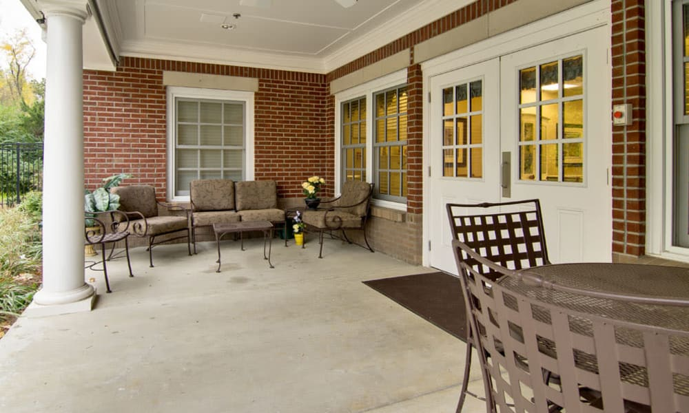 Concrete patio with a planter box at Schilling Gardens Senior Living in Collierville, Tennessee