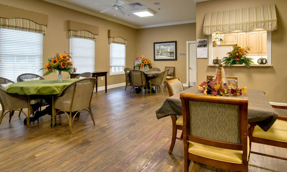 Community kitchen with dining room seating at Schilling Gardens Senior Living in Collierville, Tennessee