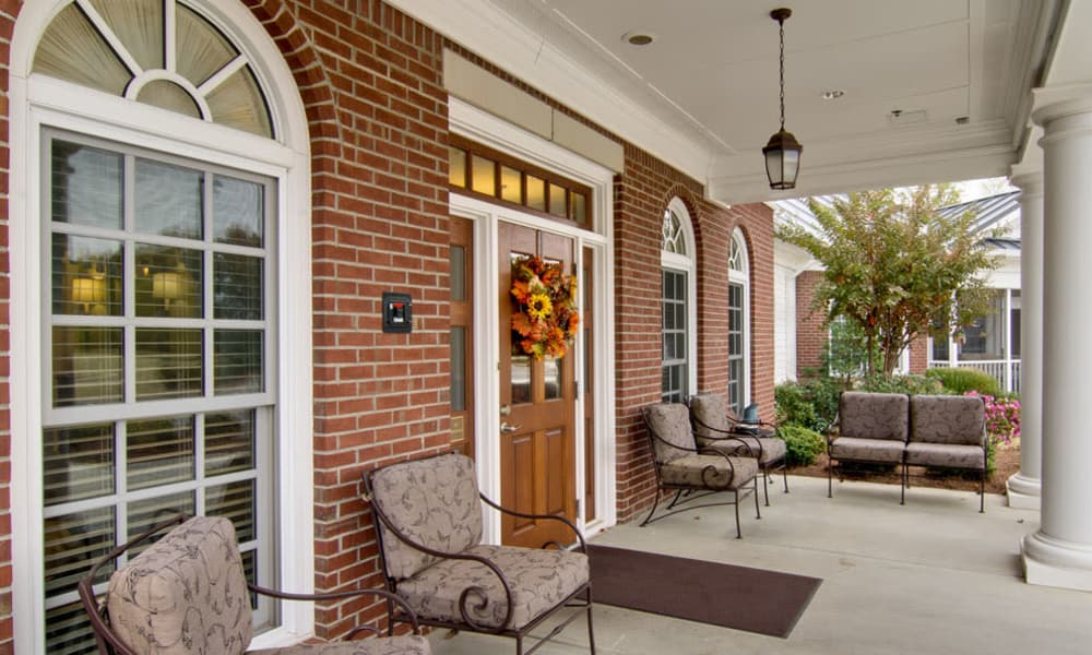 The front porch with seating at Schilling Gardens Senior Living in Collierville, Tennessee