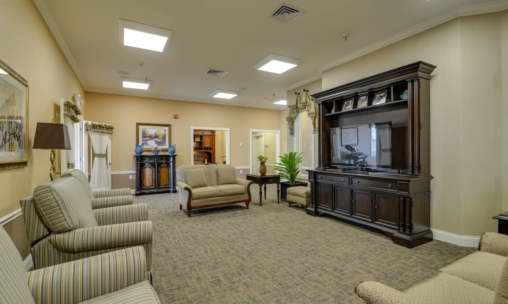 Entertainment room with comfortable seating at Colony Pointe Senior Living in Columbia, Missouri