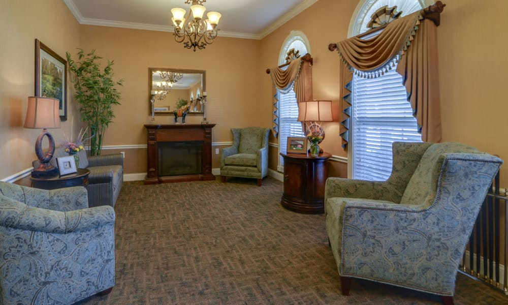 Community lounge with fireside seating at Colony Pointe Senior Living in Columbia, Missouri