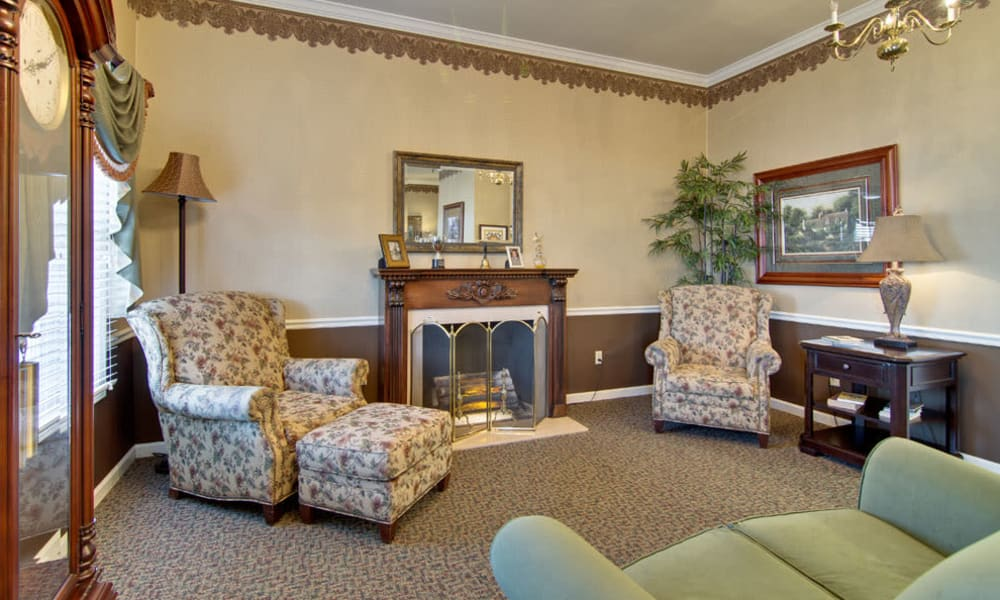 Fireside seating in the lobby at Etheridge House Senior Living in Union City, Tennessee