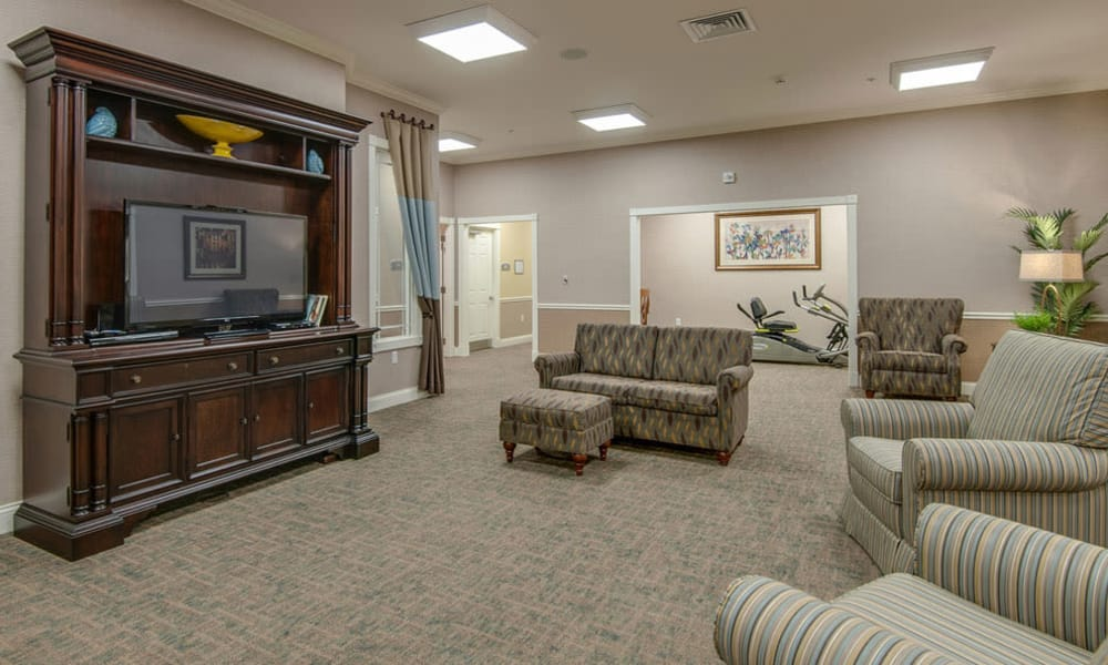 Entertainment room with comfortable seating at South Breeze Senior Living in Memphis, Tennessee