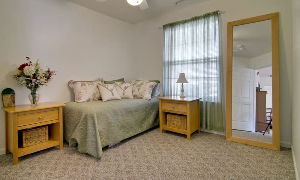 Apartment bedroom at St. Francis Park Senior Living in Kennett, Missouri