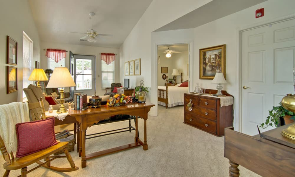 Model living room with a view of the bedroom at St. Francis Park in Kennett, Missouri