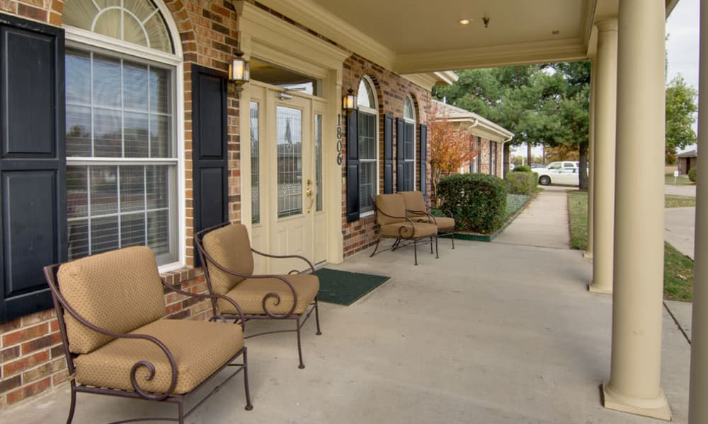 Outdoor sitting area on the front porchat St. Francis Park Senior Living in Kennett, Missouri