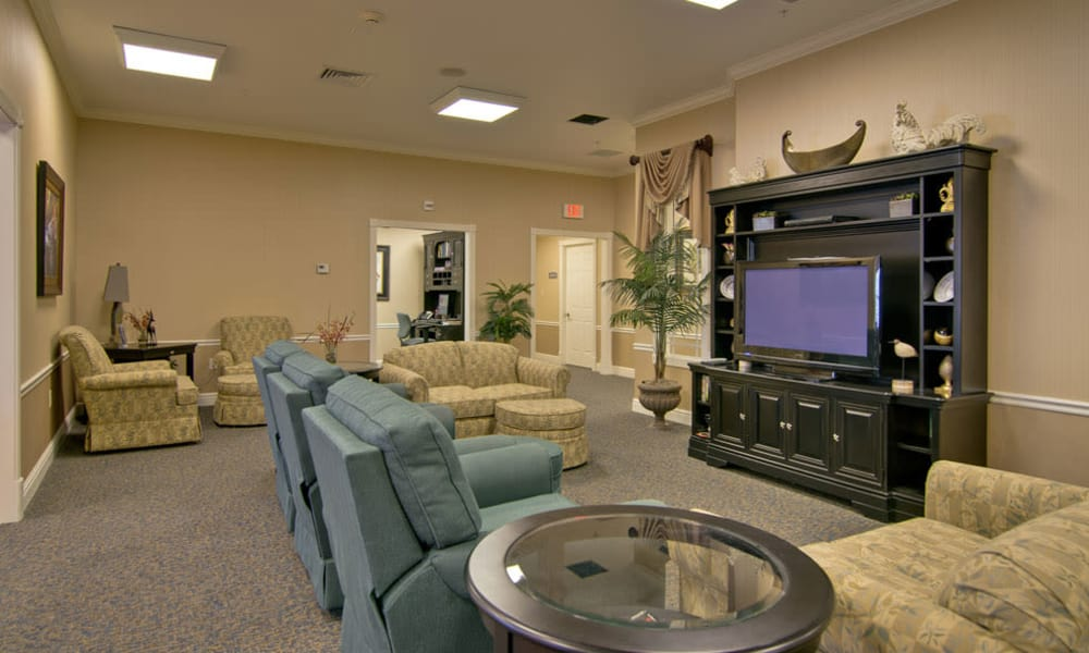 Entertainment room with comfortable seating at Hartmann Village Senior Living in Boonville, Missouri