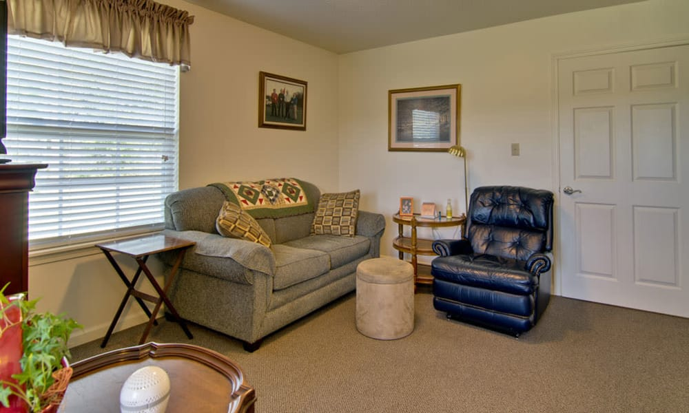 Assisted Living model living room with comfortable seating at Foxberry Terrace in Webb City, Missouri