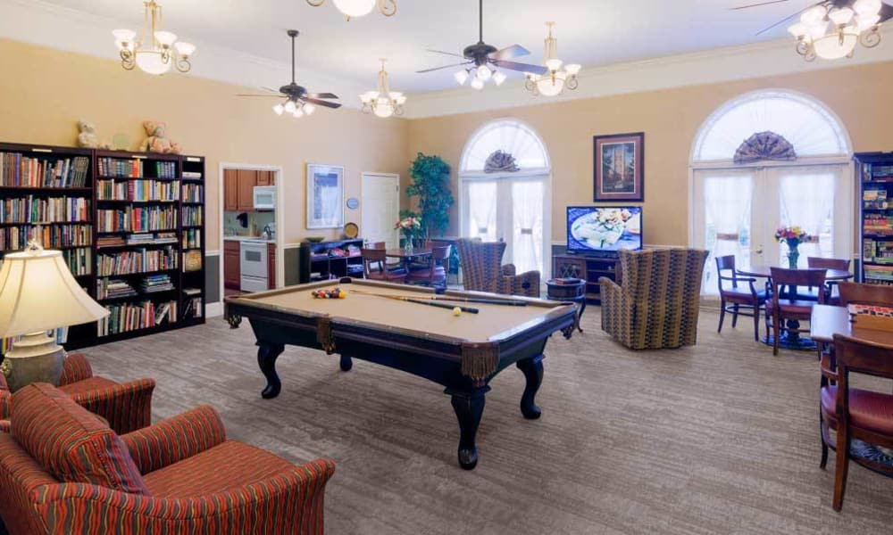 Lounge with a pool table, spaces to read and a television area at TigerPlace in Columbia, MO