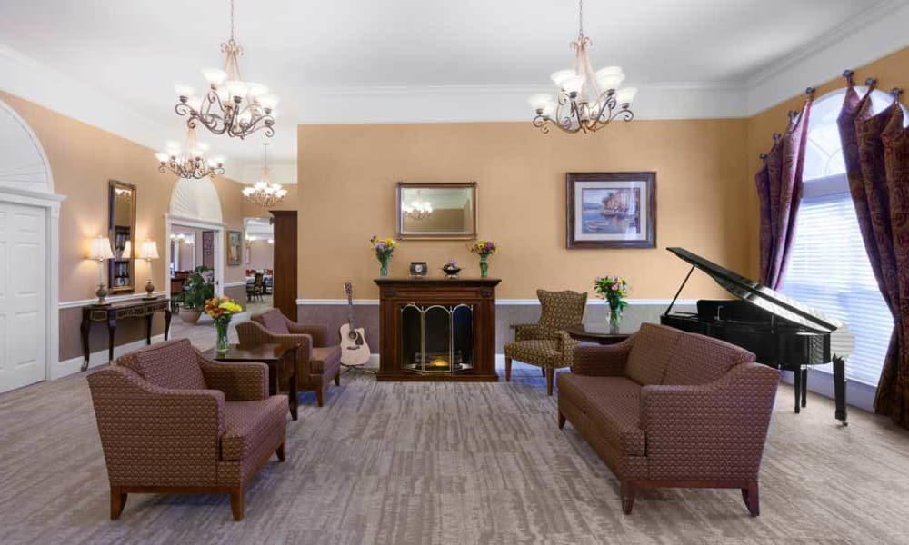 Music room with comfortable fireside seating at TigerPlace in Columbia, Missouri