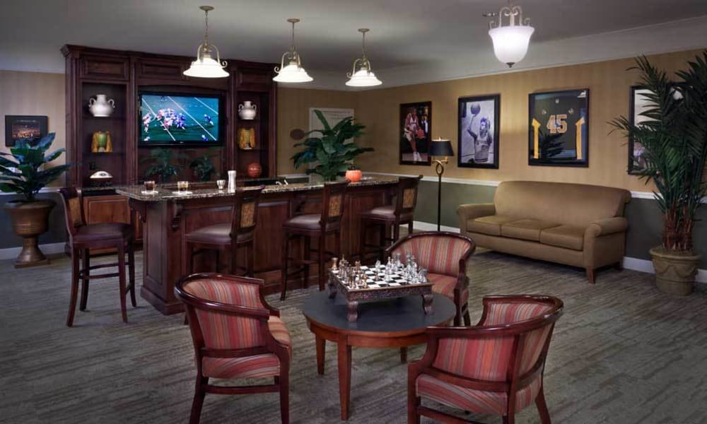 Entertainment room with bar side seating at TigerPlace in Columbia, Missouri