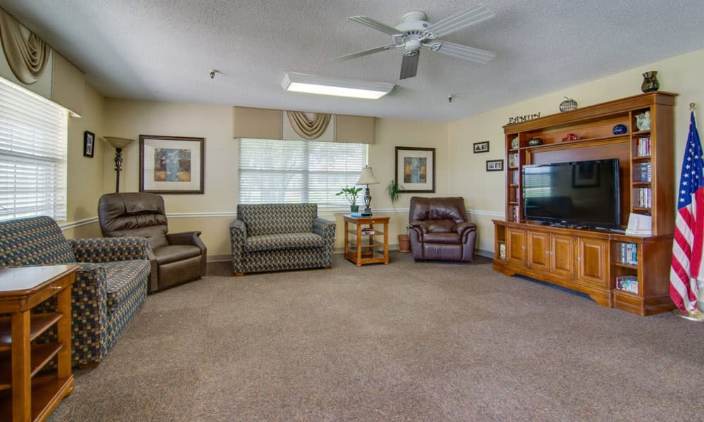 Entertainment room with comfortable seating at Moran Manor in Moran, Kansas