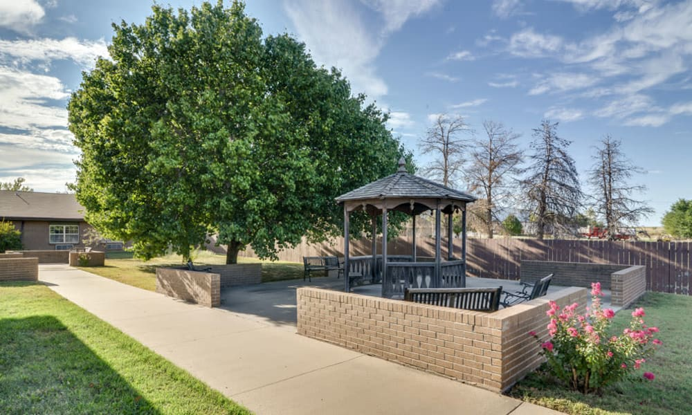Concrete patio with seating under the gazebo at Eureka Nursing in Eureka, Kansas