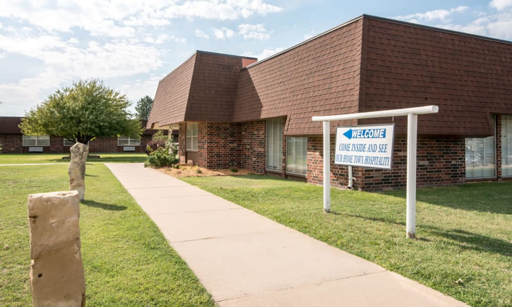 Sign leading to the main entrance at Wheatland Nursing Center in Russell, Kansas