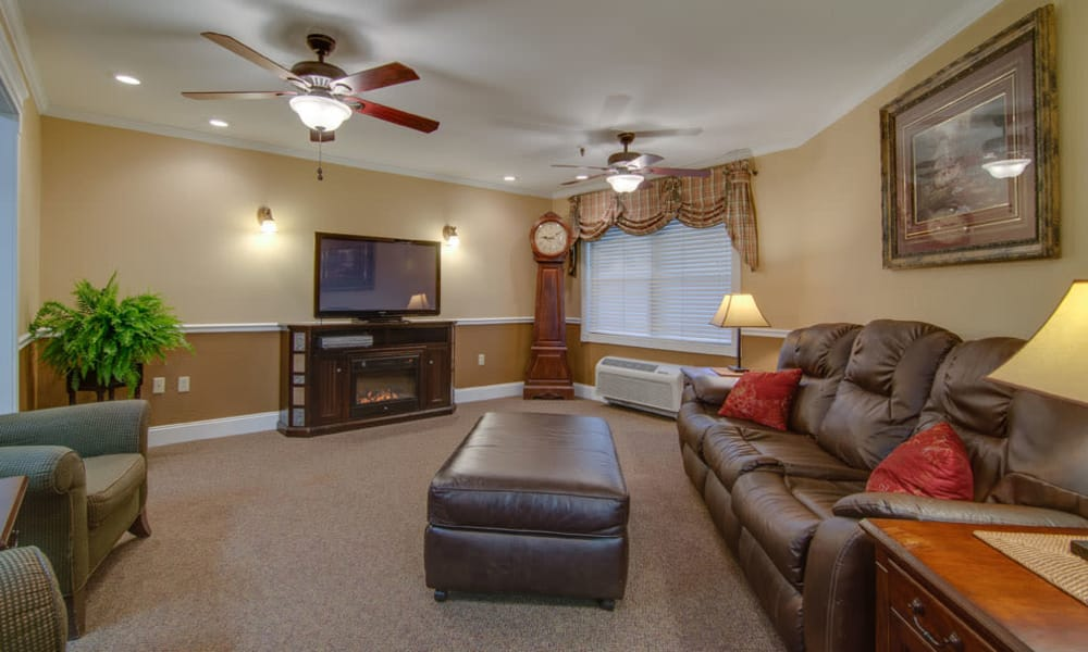 Community entertainment room with comfortable seating at Osage Nursing Center in Osage City, Kansas