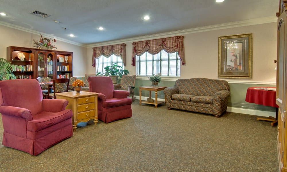 Community library with quiet reading spaces at Heritage Nursing Center in Kennett, Missouri