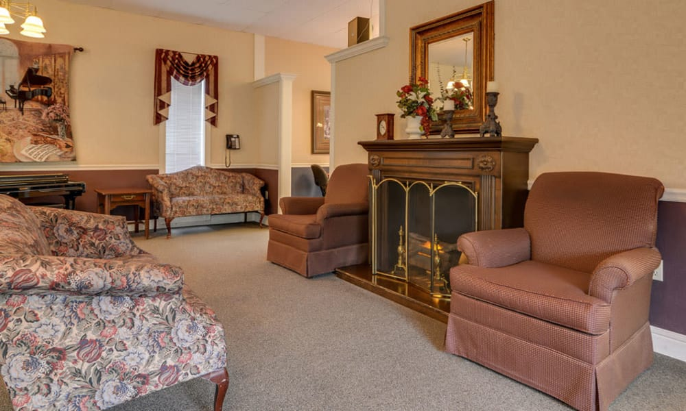 Lounge with fireside seating at Birch Tree Place in Birch Tree, Missouri