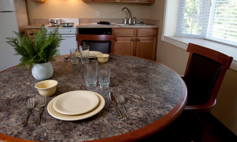 Community kitchen and dining tables at The Neighborhoods by TigerPlace in Columbia, Missouri