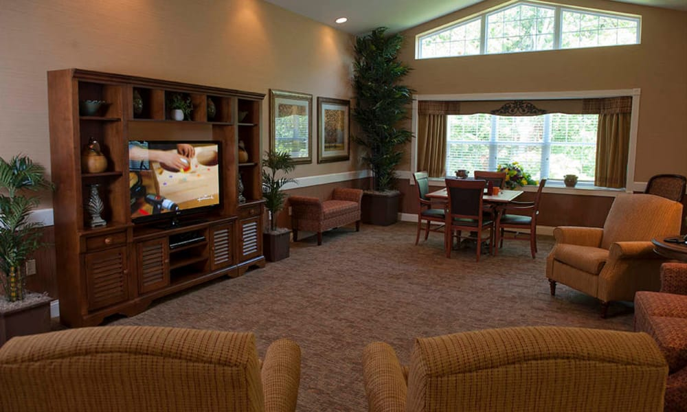 Entertainment room with comfortable seating at The Neighborhoods by TigerPlace in Columbia, Missouri