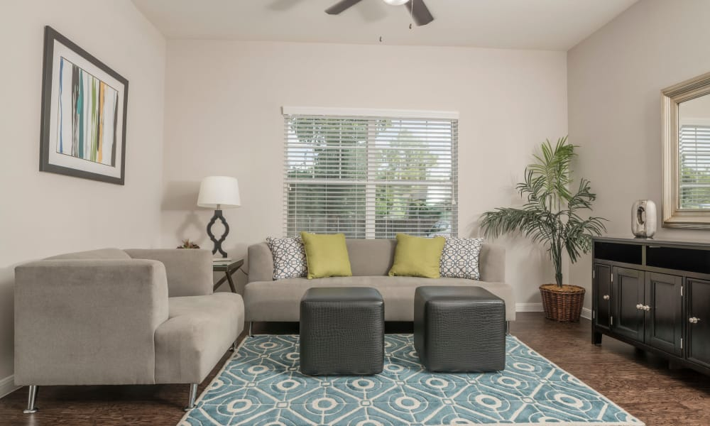 Naturally well-lit living room at Cambria Cove Apartments in Houston, Texas