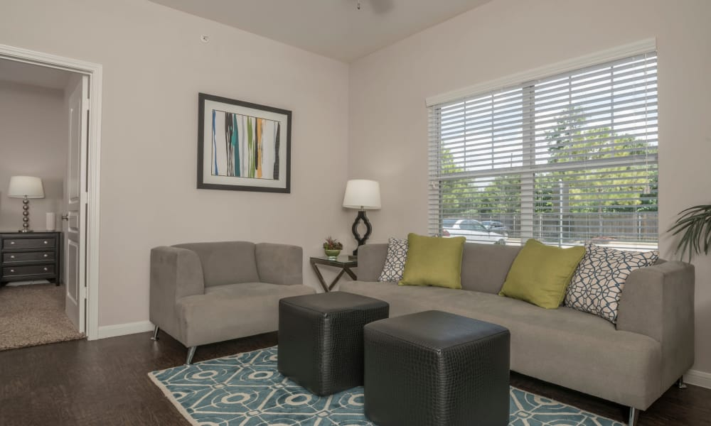 Cambria Cove Apartments offers a naturally well-lit living room in Houston, Texas