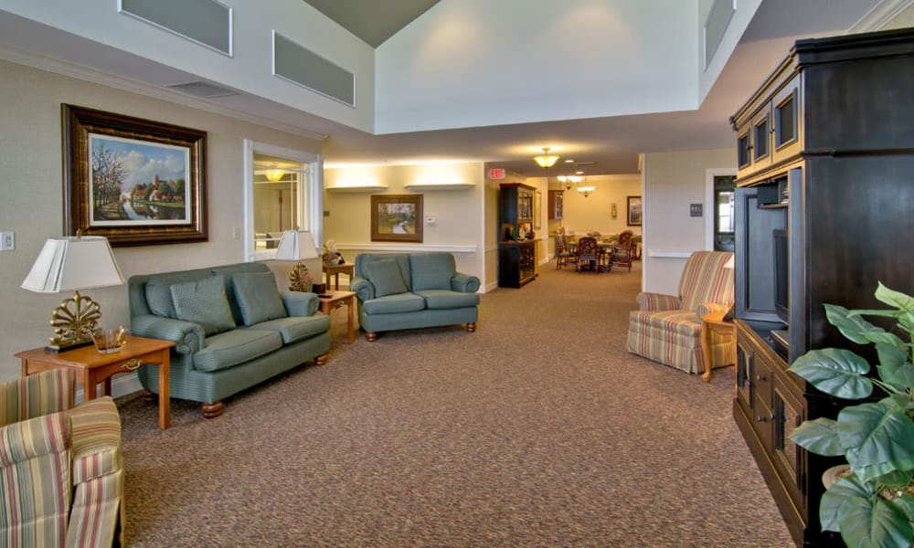 Entertainment room with comfortable seating at The Neighborhoods at Quail Creek in Springfield, Missouri