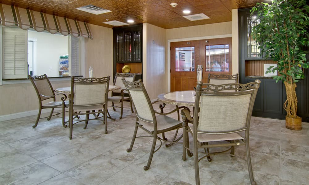 Dining room seating at The Neighborhoods at Quail Creek in Springfield, MO