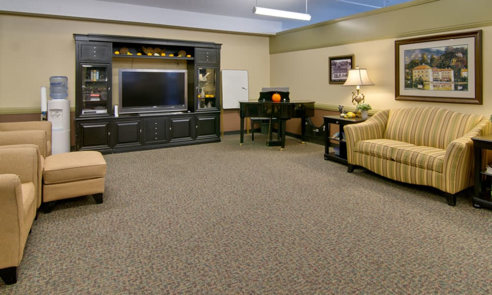 Entertainment room with comfortable seating at Heritage Hall in Centralia, Missouri