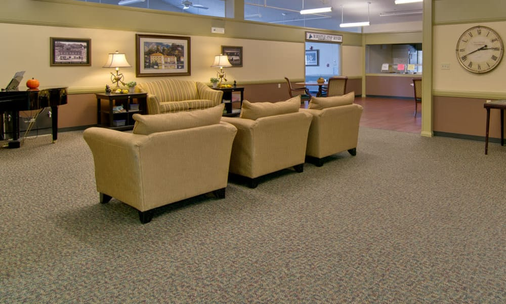 Lounge with a piano and comfortable seating at Heritage Hall in Centralia, Missouri