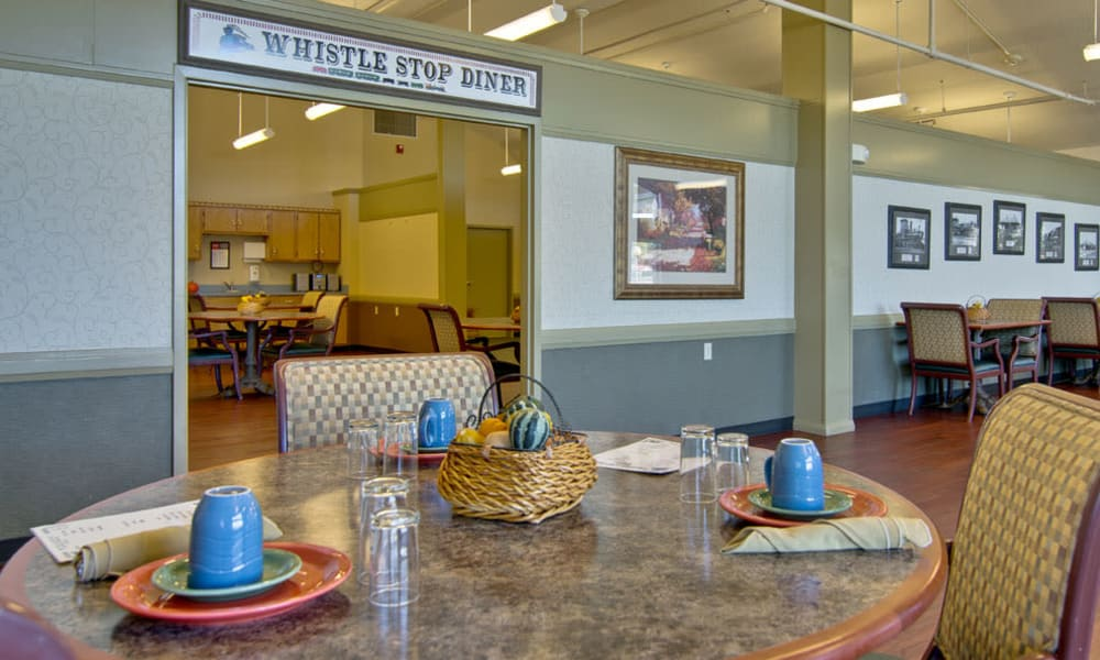Dining room seating with a view of the kitchen at Heritage Hall in Centralia, Missouri