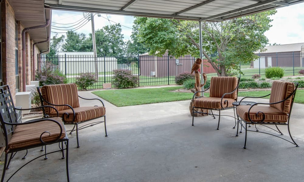 Back porch with covered seating at Chaffee Nursing Center in Chaffee, Missouri