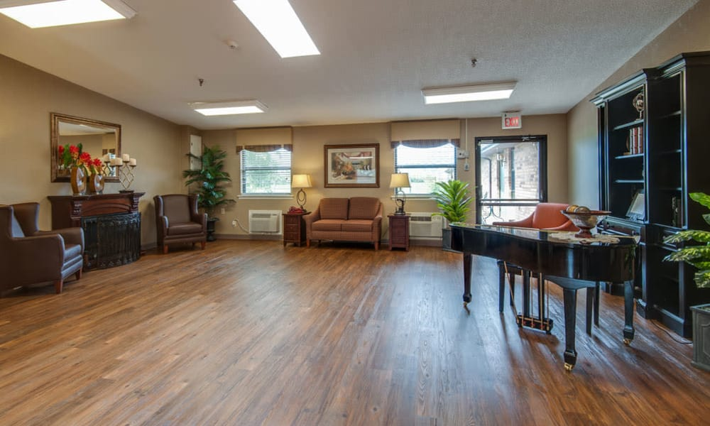 Piano room with seating at Chaffee Nursing Center in Chaffee, MO