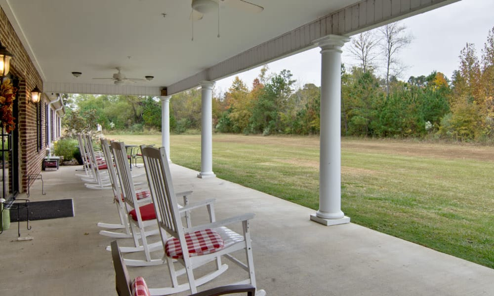 Covered outdoor seating on the patio at Montgomery Gardens in Starkville, Mississippi