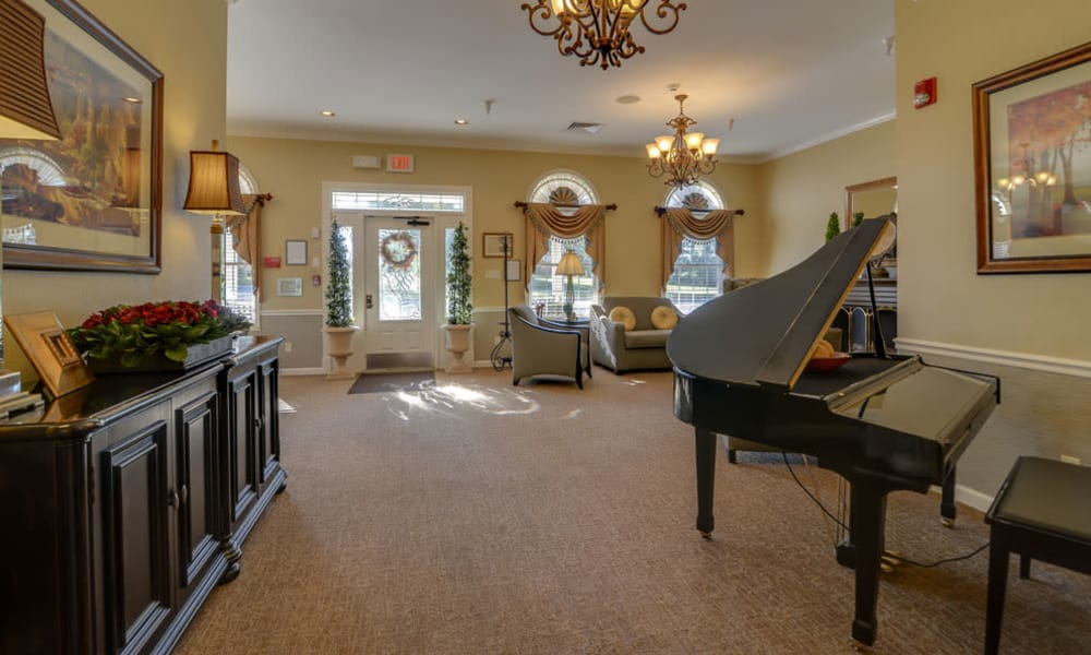 Music room with a piano and cozy seating at Springfield Heights in Springfield, TN