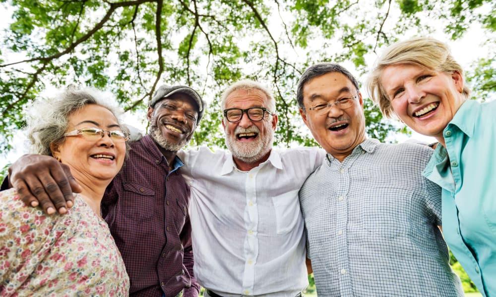 Seniors posing for a group photo at Battle Creek Memory Care in Salem, Oregon