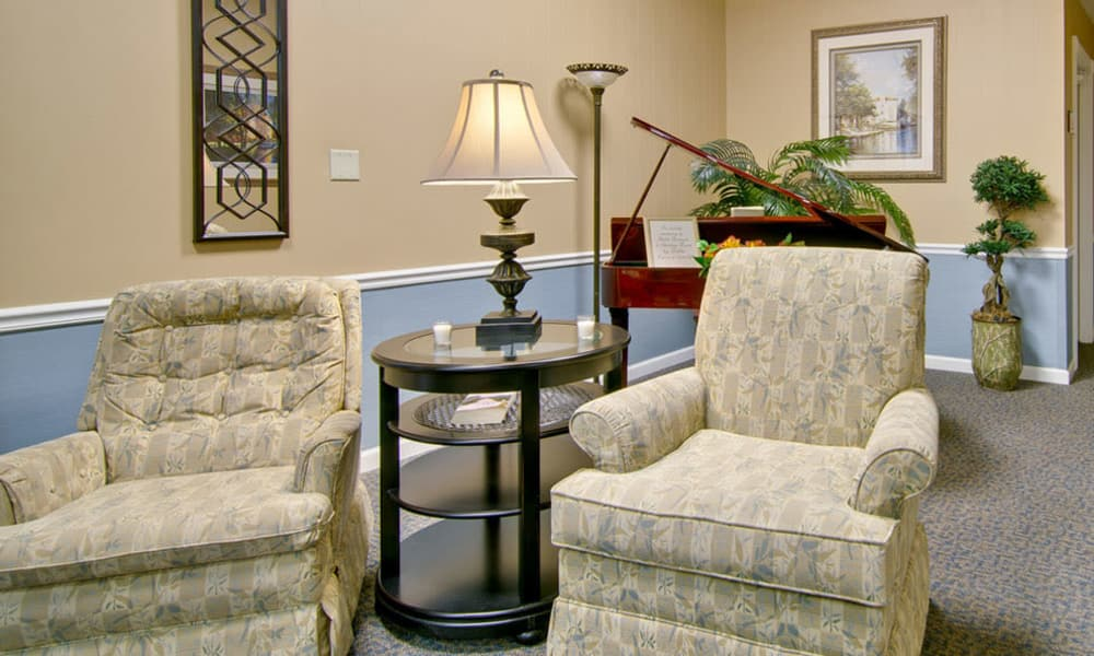 Music room with comfortable seating at Asbury Cove in Ripley, TN