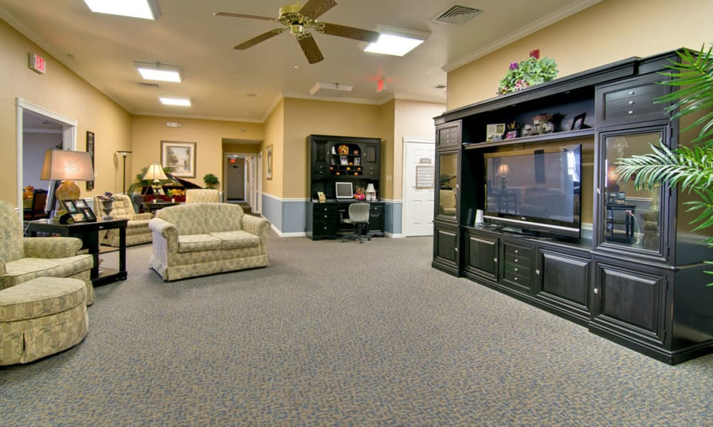 Entertainment room with comfortable seating at Asbury Cove in Ripley, Tennessee