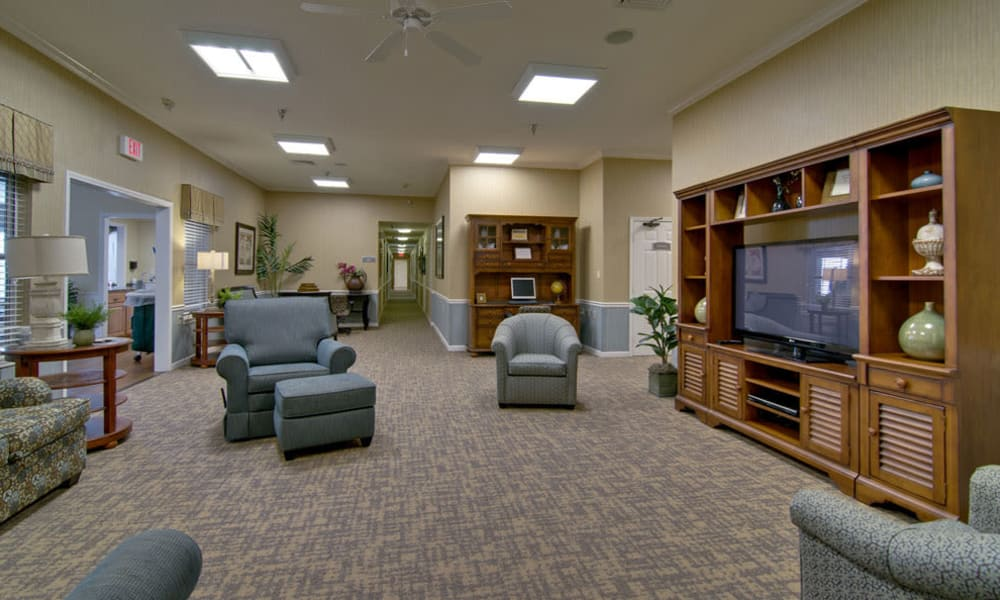 Entertainment room with comfortable seating at Churchill Terrace in Fulton, Missouri