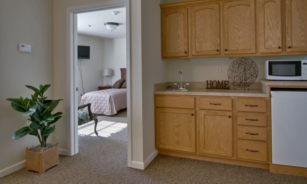 Apartment kitchen with a view of the bedroom at Churchill Terrace in Fulton, Missouri
