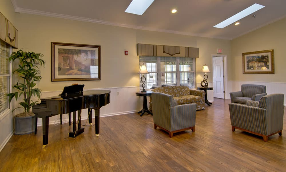 Music room with comfortable seating at Churchill Terrace in Fulton, MO