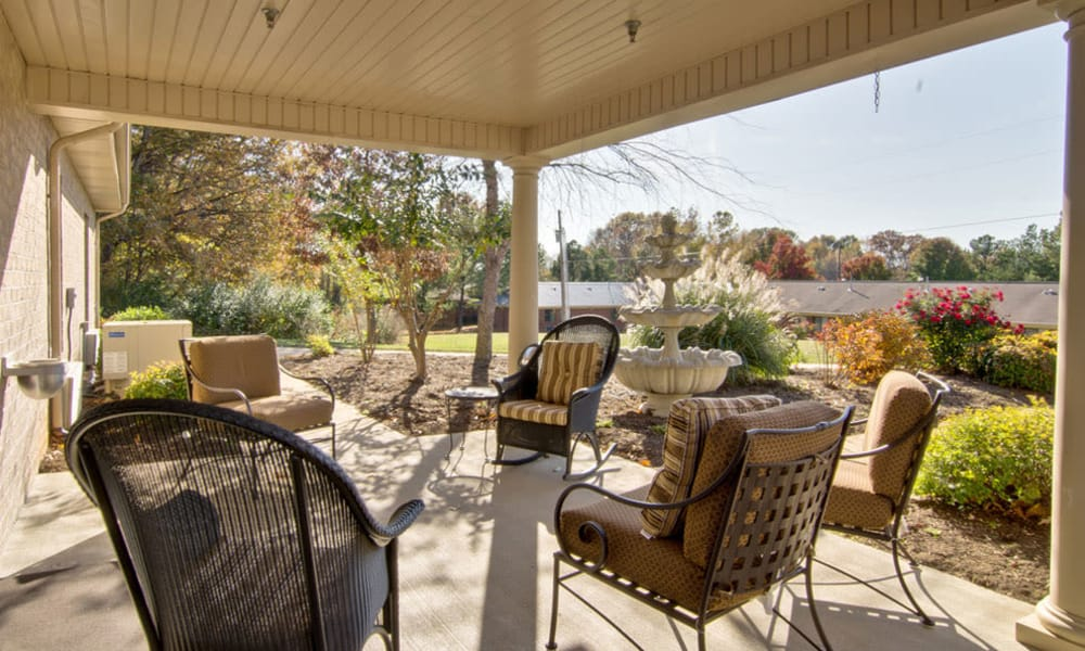 Back porch with covered seating at Greenbrier Meadows in Martin, Tennessee